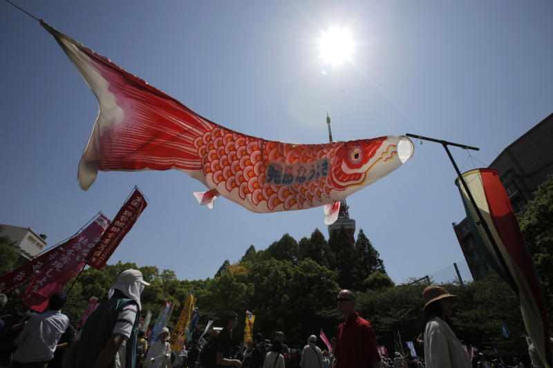 "A traditional ""Koinobori"" carp-shaped banner for Children's Day flies at a rally protesting against the usage of nuclear energy in Tokyo, Saturday, May 5, 2012. Thousands of Japanese marched to celebrate the last of this nation's 50 nuclear reactors switching off Saturday, shaking banners shaped as giant fish that have become a potent anti-nuclear symbol. (AP Photo/Itsuo Inouye)"
