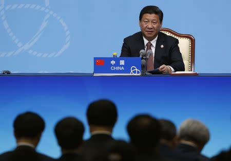 China's President Xi Jinping delivers a speech to the media during the fourth CICA summit in Shanghai