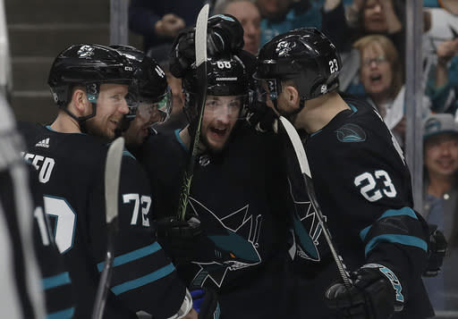San Jose Sharks center Melker Karlsson, center, is congratulated by teammates after scoring a goal against the Florida Panthers during the first period of an NHL hockey game in San Jose, Calif., Thursday, March 14, 2019. (AP Photo/Jeff Chiu)