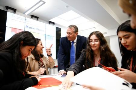 Britain's Secretary of State for International Trade Liam Fox visits students taking part in a mock trade negotiation at Harris Westminster Sixth Form college in central London