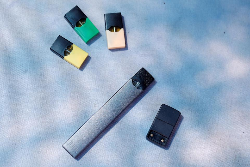 A Juul e-cigarette uses nicotine-filled removable pods that come in a variety of flavors. Critics says those flavors have helped attract underage users. REUTERS/Ronen Zvulun