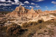 <p>Beautiful spring clouds roam over the formation at the Badlands National Park, South Dakota // May 14, 2007</p>