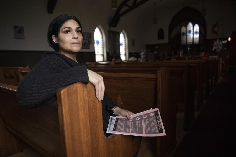 In this Wednesday, June 19, 2019 photo, Cecilia Garcia, member of La Familia Latina Unida and founder of Family Reunification not Deportation, poses for a portrait after an emergency meeting plan of action on how to defend and protect undocumented communities of deportation ahead of President Donald J. Trump's announcement on immigration at Lincoln Methodist Church in Chicago's Pilsen neighborhood.  Garcia's husband had been deported to Mexico after telling a suburban Chicago police officer during a 2012 traffic stop that he was living in the U.S. illegally. (AP Photo/Amr Alfiky)