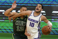 Sacramento Kings guard Justin James (10) drives against Boston Celtics forward Grant Williams (12) in the first half of an NBA basketball game, Friday, March 19, 2021, in Boston. (AP Photo/Elise Amendola)