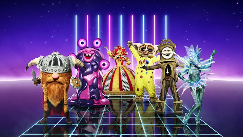 "<p><a href=""https://www.digitalspy.com/masked-singer/"" rel=""nofollow noopener"" target=""_blank"" data-ylk=""slk:The Masked Singer UK"" class=""link rapid-noclick-resp"">The Masked Singer UK</a> is set to return to our screens on December 26, and we're getting our first look at all the crazy costumes.</p><p>Just when we thought things couldn't get any bigger and better, ITV unveiled 12 brand new outrageous outfits in all their glory, including an alien, a seahorse, and even a grandfather clock. There's also a sausage thrown in for good measure.</p><p>We previously <a href=""https://www.digitalspy.com/tv/reality-tv/a34804985/the-masked-singer-uk-series-2-costumes/"" rel=""nofollow noopener"" target=""_blank"" data-ylk=""slk:got a sneak peek"" class=""link rapid-noclick-resp"">got a sneak peek</a> at what we can expect last week. A teaser video that gave us a glimpse at the new crop of celebrities in all their costumed splendour, but this is the first time we can actually zoom in and out to scour the outfits for clues (not that they're actually giving much away just yet).</p><p>The big reveal comes shortly after it was announced that the UK version of the show will be returning to our screens with a brand new judge. <a href=""https://www.digitalspy.com/tv/reality-tv/a33648772/masked-singer-uk-mo-gilligan-new-judge/"" rel=""nofollow noopener"" target=""_blank"" data-ylk=""slk:Mo Gilligan"" class=""link rapid-noclick-resp"">Mo Gilligan</a> is replacing Ken Jeong on the panel alongside returnees Davina McCall, Rita Ora and Jonathan Ross.</p><p>Speaking to <strong>Digital Spy</strong> about the new addition, <a href=""https://www.digitalspy.com/tv/reality-tv/a34247270/masked-singer-uk-season-2-judges-mo-gilligan/"" rel=""nofollow noopener"" target=""_blank"" data-ylk=""slk:host Joel Dommett"" class=""link rapid-noclick-resp"">host Joel Dommett</a> had nothing but praise for the newcomer as he called Mo ""so good"" and ""brilliant"" during filming. </p><p>""It was nice to have someone new in the mix. He threw out a lot of hilarious names, as did everyone. The panel is brilliant this year. We're so lucky, everyone gets along – there are no crazy divas,"" he added.<br><br><strong>The Masked Singer UK</strong><strong> will return to ITV on December 26 at 7pm.</strong><br></p>"
