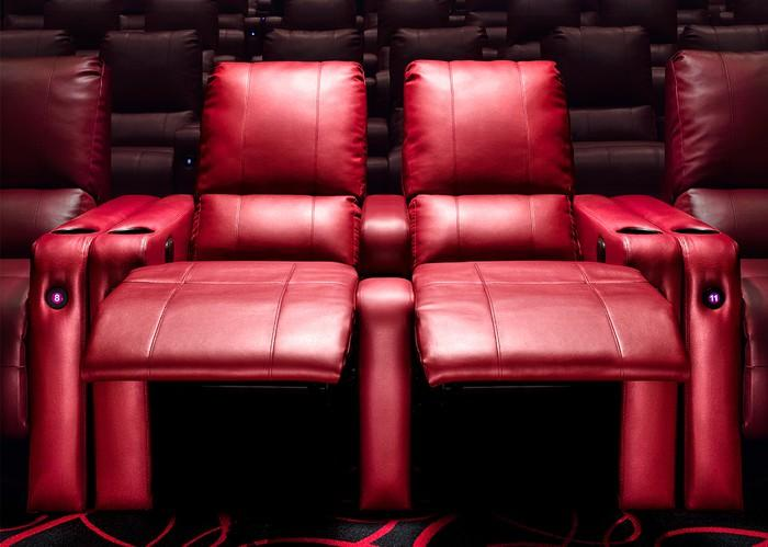 A pair of reclining leather seats at an AMC theater.