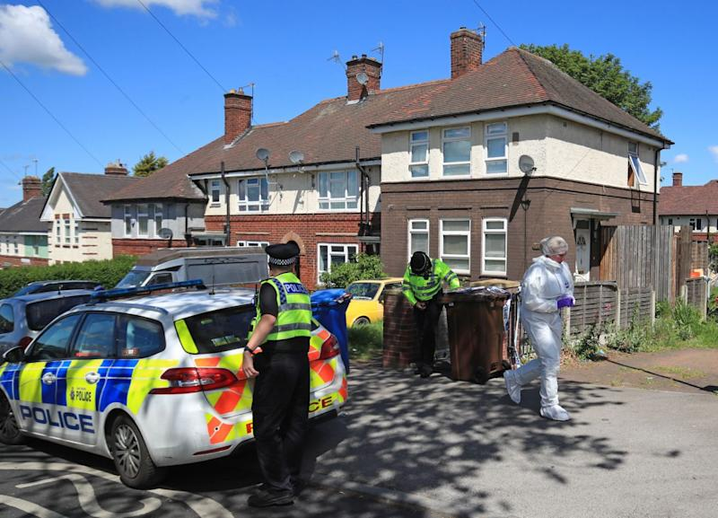 Police at a property on Gregg House Road in Shiregreen, Sheffield, in May (Picture: PA)