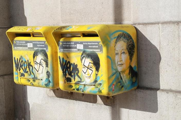 """French society is in trouble,"" the son of the late Simone Veil said as he looked at the swastikas daubed on two post boxes decorated with pictures of his mother, a Holocaust survivor (AFP Photo/JACQUES DEMARTHON)"