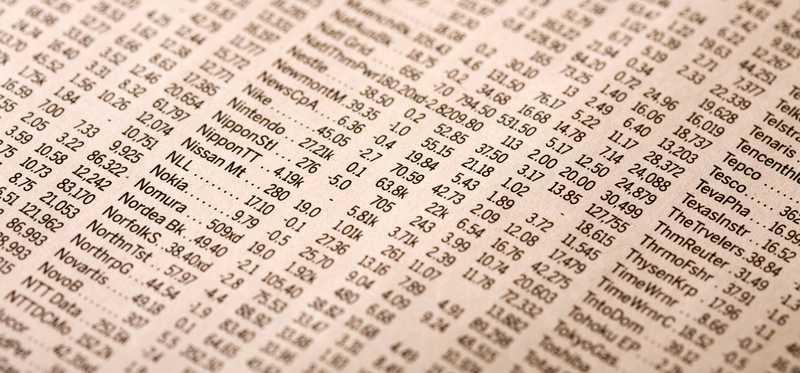 Stock quotes on a newspaper page.