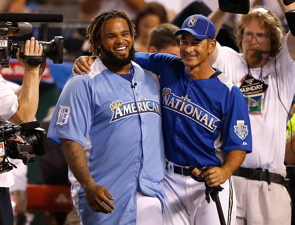 KANSAS CITY, MO - JULY 09:  American League All-Star Prince Fielder #28 of the Detroit Tigers celebrates with pitcher Sandy Guerrero after winning the State Farm Home Run Derby at Kauffman Stadium on July 9, 2012 in Kansas City, Missouri.  (Photo by Jamie Squire/Getty Images)