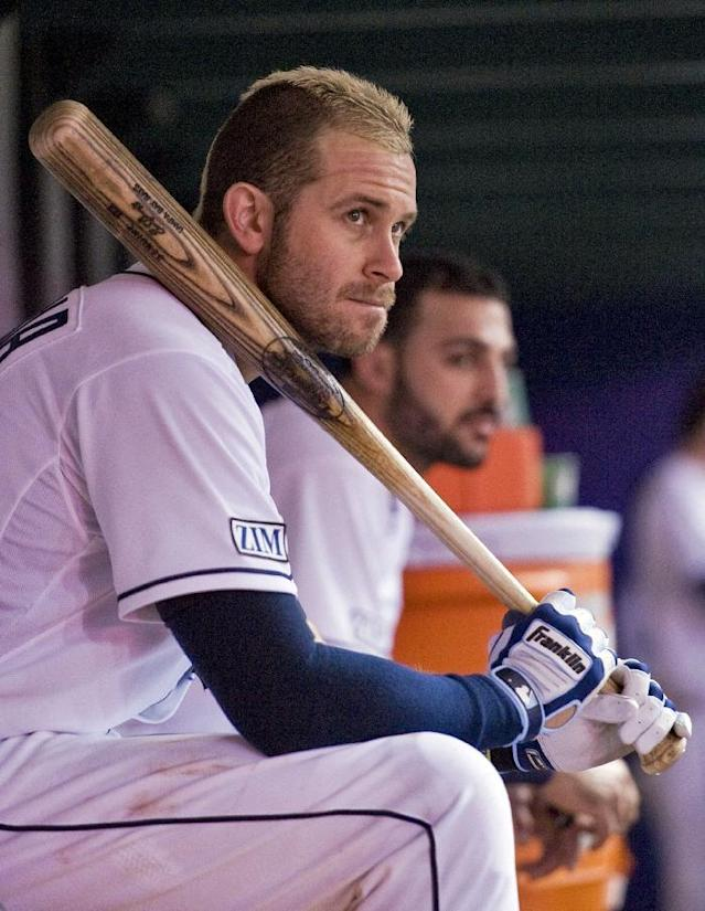 Tampa Bay Rays' Evan Longoria, left, and Sean Rodriguez watch the game from the dugout during the sixth inning of a baseball game against the Kansas City Royals, Monday, July 7, 2014, in St. Petersburg, Fla. (AP Photo/Steve Nesius)