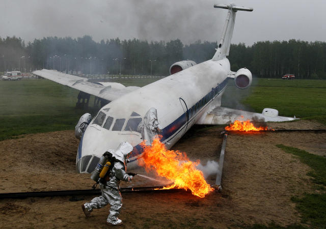 Firemen wear protective clothing as they extinguish flames during simulation exercises by the Russian Emergency Situations Ministry, at their Rescue Training Centre on May 24, 2013 in Noginsk, outside Moscow, Russia.