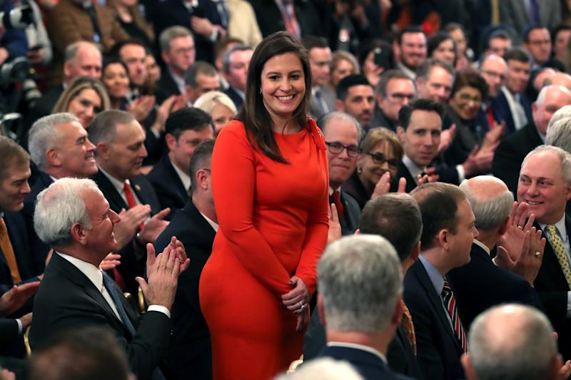 WASHINGTON, DC - FEBRUARY 06: Rep. Elise Stefanik (R-NY) (C) stands as she's acknowledged by U.S. President Donald Trump as he speaks one day after the U.S. Senate acquitted on two articles of impeachment, in the East Room of the White House February 6, 2020 in Washington, DC. After five months of congressional hearings and investigations about President Trump's dealings with Ukraine, the U.S. Senate formally acquitted the president of charges that he abused his power and obstructed Congress. (Photo by Mark Wilson/Getty Images)