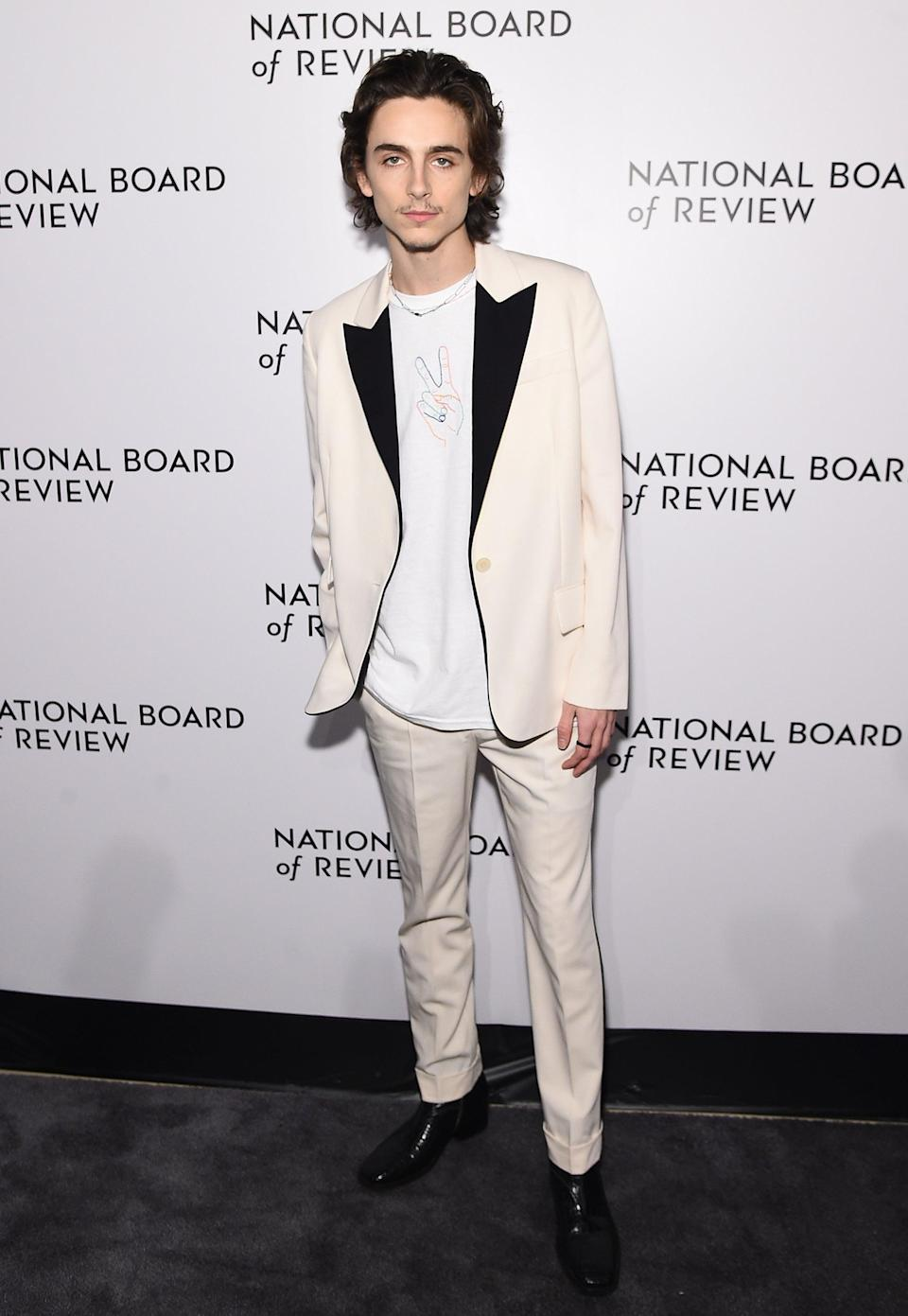 "<h2>Stella McCartney</h2>The only thing better than Timothée in a Stella McCartney suit is Timothée in a Stella McCartney suit with a <a href=""https://www.refinery29.com/en-us/2020/01/9178463/timothee-chalamet-peace-shirt-red-carpet-fashion-avery-warsaw"" rel=""nofollow noopener"" target=""_blank"" data-ylk=""slk:fan-made T-shirt underneath"" class=""link rapid-noclick-resp"">fan-made T-shirt underneath</a>. <span class=""copyright"">Photo: Jamie McCarthy/Getty Images.</span>"