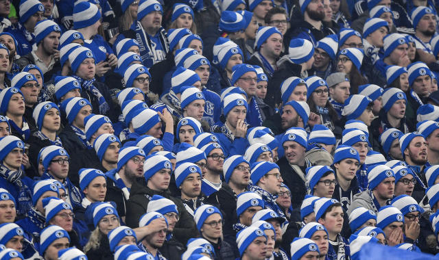 Schalke supporters wear blue and white winter hats during the German Bundesliga soccer match between FC Schalke 04 and Borussia Dortmund at the Arena in Gelsenkirchen, Germany, Saturday, Dec. 8, 2018. (AP Photo/Martin Meissner)