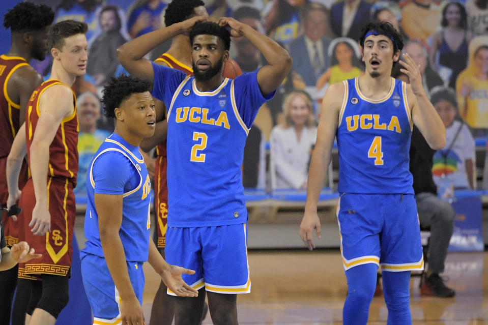 UCLA guard Jaylen Clark, second from left, forward Cody Riley, second from right, and guard Jaime Jaquez Jr., right, react to a foul call as Southern California guard Drew Peterson, left, looks on during the second half of an NCAA college basketball game Saturday, March 6, 2021, in Los Angeles. USC won 64-63. (AP Photo/Mark J. Terrill)