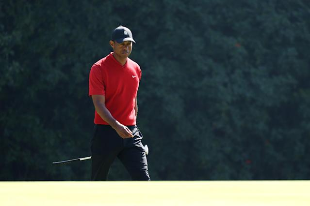 "Though he's only played three times this season, <a class=""link rapid-noclick-resp"" href=""/pga/players/147/"" data-ylk=""slk:Tiger Woods"">Tiger Woods</a> is ""just not quite ready"" to return to the course while dealing with back stiffness. (Chris Trotman/Getty Images)"