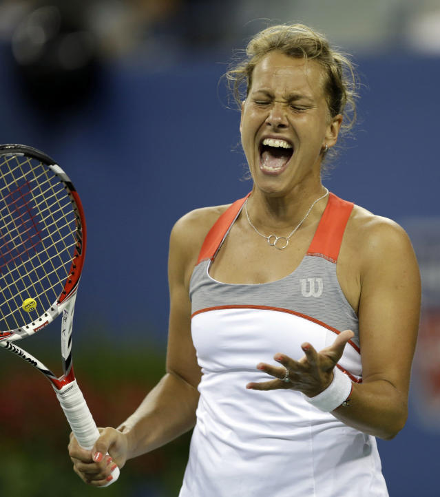 Barbora Zahlavova Strycova, of the Czech Republic, reacts after a shot to Eugenie Bouchard, of Canada, during the third round of the 2014 U.S. Open tennis tournament Saturday, Aug. 30, 2014, in New York. (AP Photo/Darron Cummings)