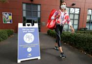 Signs at the US Open remind players to wash their hands and wear masks