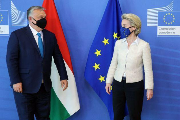 Hungarian Prime Minister Viktor Orban (L) is welcomed by European Commission President Ursula von der Leyen in the Berlaymont building at the EU headquarters in Brussels on April 23, 2021. (Photo by François WALSCHAERTS / various sources / AFP) (Photo by FRANCOIS WALSCHAERTS/AFP via Getty Images) (Photo: FRANCOIS WALSCHAERTS via Getty Images)