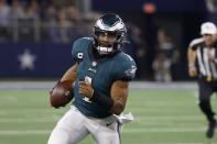 Philadelphia Eagles quarterback Jalen Hurts (1) runs the ball in the second half of an NFL football game against the Dallas Cowboys in Arlington, Texas, Monday, Sept. 27, 2021. (AP Photo/Ron Jenkins)