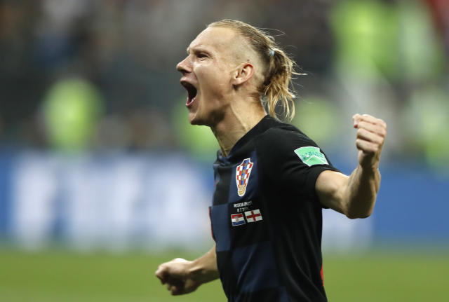 Croatia's Domagoj Vida celebrates after his team advanced to the final during the semifinal match between Croatia and England at the 2018 soccer World Cup in the Luzhniki Stadium in Moscow, Russia, Wednesday, July 11, 2018. (AP Photo/Frank Augstein)