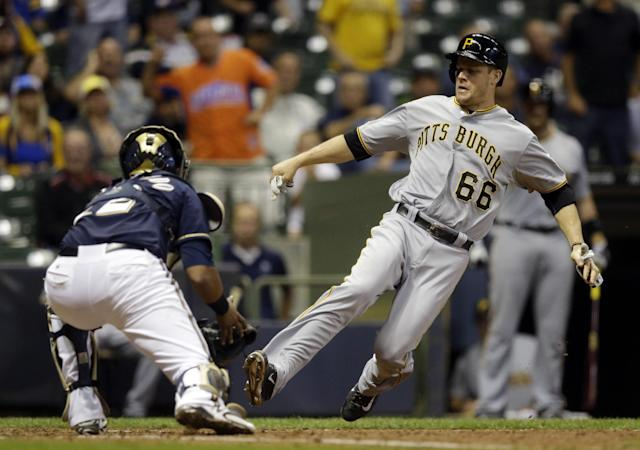 Milwaukee Brewers catcher Martin Maldonado, left, tags out Pittsburgh Pirates' Justin Morneau at home during the fifth inning of a baseball game on Wednesday, Sept. 4, 2013, in Milwaukee. Morneau tried to score from first on a hit by Marlon Byrd. (AP Photo/Morry Gash)