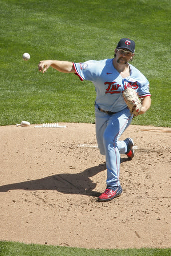 Minnesota Twins starting pitcher Randy Dobnak throws to the Kansas City Royals in the first inning of a baseball game Sunday, Aug. 16, 2020, in Minneapolis. (AP Photo/Bruce Kluckhohn)