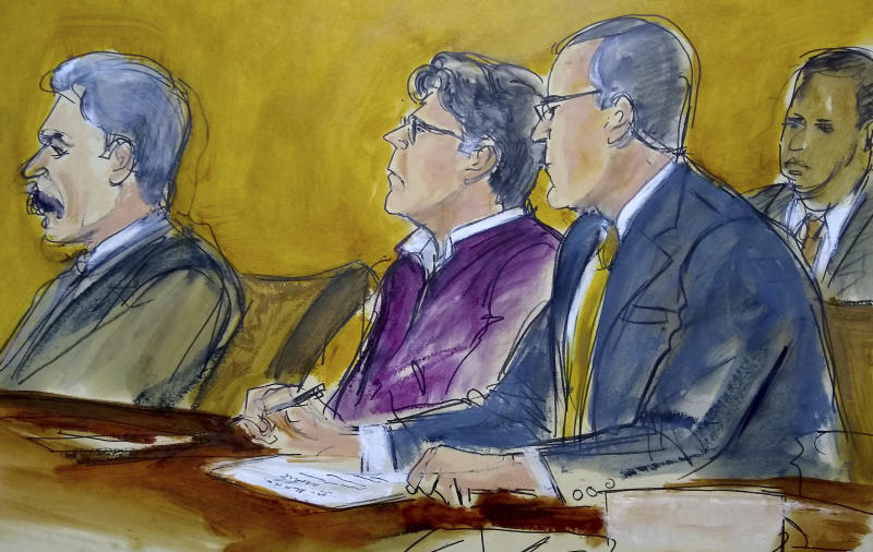 Keith Raniere (centre) shown sitting at defence table in an artist sketch from court on June 19.