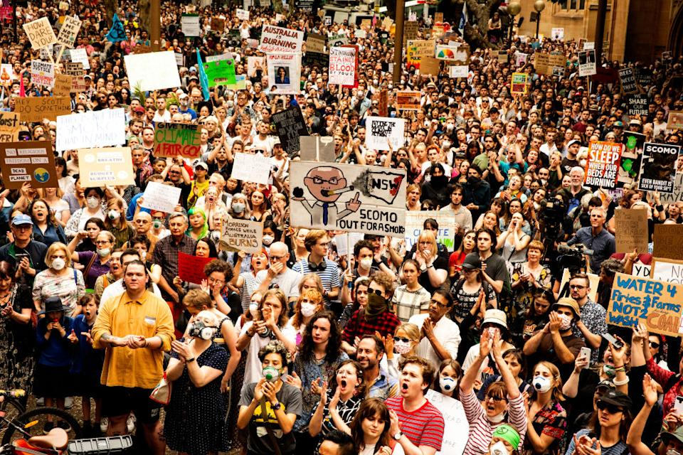 Activists rally for climate action at Sydney Town Hall on Wednesday December 11, 2019 in Sydney, Australia.