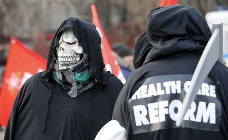 An activist wears a skull mask during a protest in support of Russian doctors and patients against reforms to the healthcare system in Moscow in this November 30, 2014 file photo.  REUTERS/Sergei Karpukhin/Files