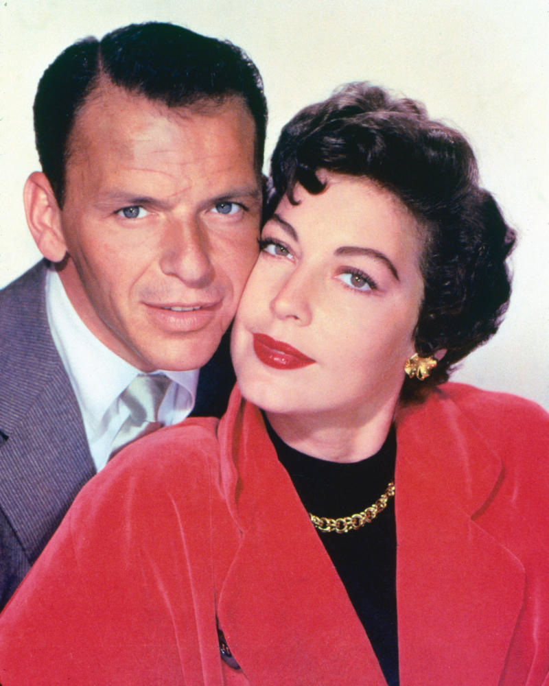 Frank Sinatra (1915-1998), US singer and actor, and his wife, US actress Ava Gardner (1922-1990), posing cheek-to-cheek in a studio portrait, against a white background, circa 1953. The couple were married in 1951 and divoced in 1957. (Photo by Silver Screen Collection/Getty Images)