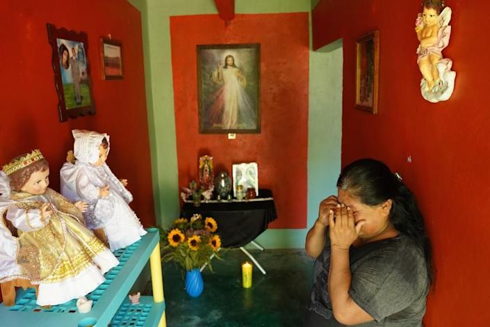 Isabel Baez Vaquero, 54, mourns the loss of her husband, Benito Medardo Tlatelpa Calixto, 58.at their home in the town oh Ahuehuetitla Mexico. He died April 13 in United States of Covid-19. His ashes were returned in July to Ahuehuetitla. The family set up an altar in their house with the urn containing his ashes.In recent months, Mexican authorities have been repatriating to Mexico the ashes of hundreds of Mexican citizens who died of Covid-19 in the United States. Health restrictions during the pandemic largely made it impossible to send back bodies to Mexico. Among the hardest-hit towns was Ahuehuetitla, in Puebla state, which has long sent migrants to the New York City area. In all, authorities say, 26 people from Ahuehuetitla died of Covid-19 in the United States.