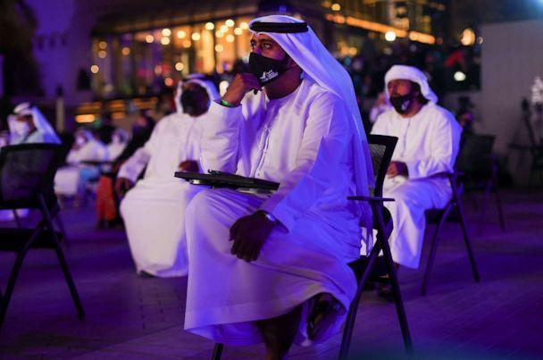 PHOTO: People watch a screen displaying information of the Hope Probe entering the orbit of Mars, in Dubai, United Arab Emirates, Feb. 9, 2021. (Christopher Pike/Reuters)