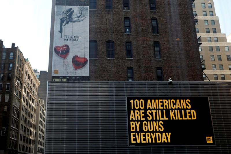 """FILE PHOTO: A """"wall of Demand"""" mural and video message created by Manuel Oliver is seen one year anniversary of the school shooting in Parkland Florida in New York"""