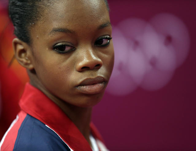 U.S. gymnast Gabrielle Douglas reacts in dejection after final results were declared for the balance beam during the artistic gymnastics women's apparatus finals at the 2012 Summer Olympics, Tuesday, Aug. 7, 2012, in London. (AP Photo/Gregory Bull)
