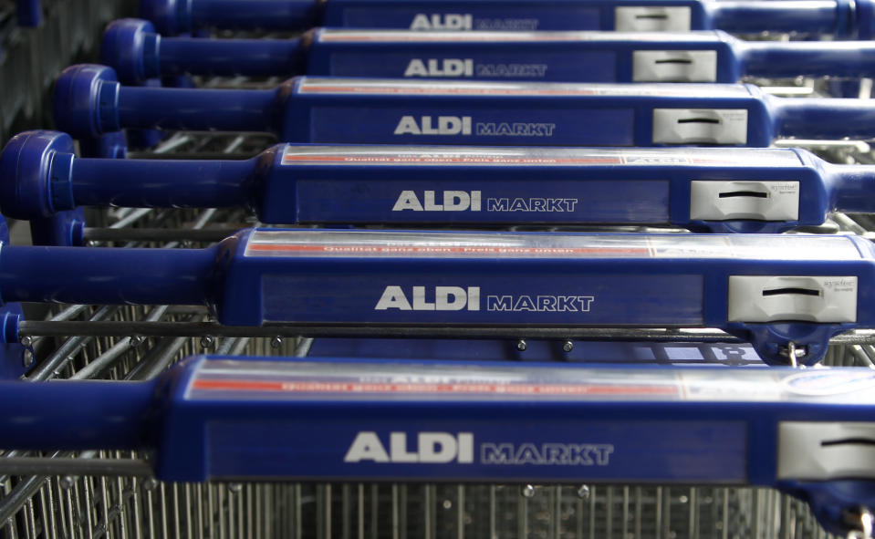 Shopping trolleys are pictured outside an Aldi supermarket in Berlin July 28, 2010. Theo Albrecht, one of Germany's wealthiest men and co-founder of the Aldi discount supermarket chain, with a fortune estimated at nearly 17 billion Euro, died on Saturday, German media reported.   REUTERS/Fabrizio Bensch (GERMANY - Tags: SOCIETY OBITUARY)