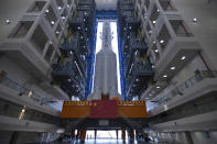 FILE - In this July 17, 2020, photo released by China's Xinhua News Agency, a Long March-5 rocket is seen at the Wenchang Space Launch Center in southern China's Hainan Province. Chinese technicians were making final preparations Monday, Nov. 23, 2020, to launch a Long March-5 rocket carrying a mission to bring back material from the lunar surface in a potentially major advance for the country's space program. (Zhang Gaoxiang/Xinhua via AP, File)