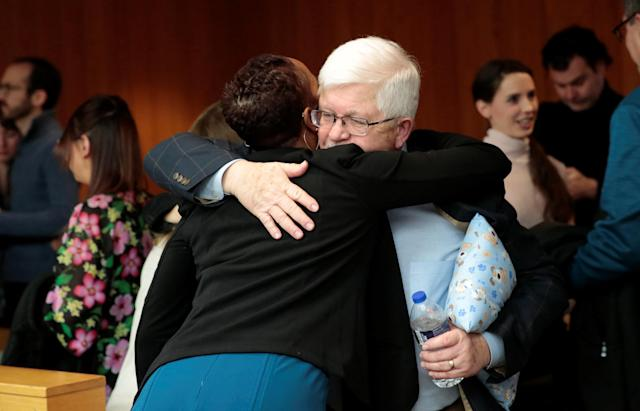 Assistant Attorney General Robyn Liddell hugs the father of former gymnast AshleyErickson during the sentencing hearing of Larry Nassar, a former team USA Gymnastics doctor who pleaded guilty in November 2017 to sexual assault charges, in the Eaton County Court in Charlotte, Michigan, U.S., February 5, 2018. REUTERS/Rebecca Cook