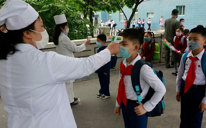 North Korea has yet to report a case of Covid-19, but it has not been immune from the economic impacts brought about by the global response to the virus - Jon Chol Jin/AP