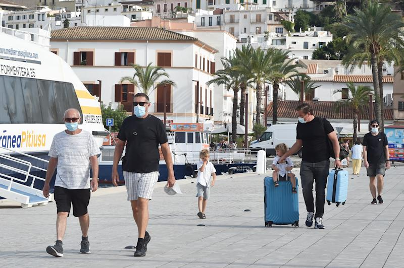 IBIZA, SPAIN - JULY 14: People wearing face masks as a preventive measure are seen on July 14, 2020 in Ibiza, Spain. Since July 12, 2020 it is mandatory to wear a mask due to the increase in infections at the national and international level. (Photo by Stephane Cardinale - Corbis/Corbis via Getty Images,)