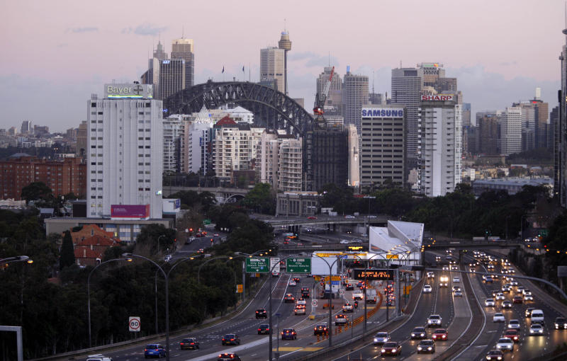 A picture of a busy northern Sydney road with the CBD's skyline in the background.