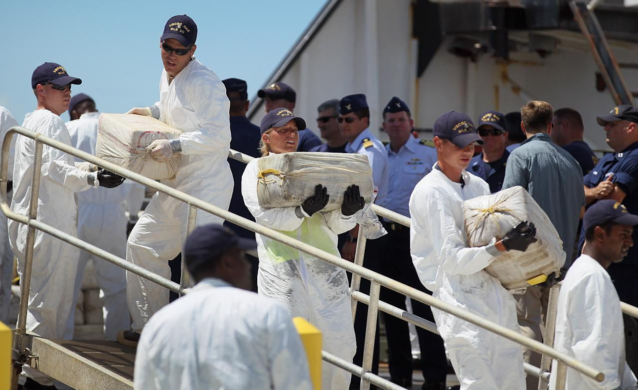 MIAMI BEACH, FL - AUGUST 02:  U.S. Coast Guard crew members from the Cutter Oak offload some of the 15,000 pounds of cocaine worth more than $180 million on August 2, 2011 in Miami Beach, Florida. The cocaine was seized from a self-propelled semi-submersible vessel in the western Caribbean Sea on July 13.  (Photo by Joe Raedle/Getty Images)