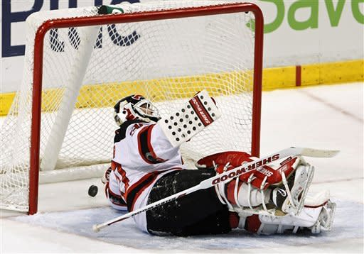 New Jersey Devils goalie Martin Brodeur is unable to stop a shot by Florida Panthers right wing Kris Versteeg during the first period of an NHL hockey game, Tuesday, Dec. 13, 2011, in Sunrise, Fla. (AP Photo/Wilfredo Lee)