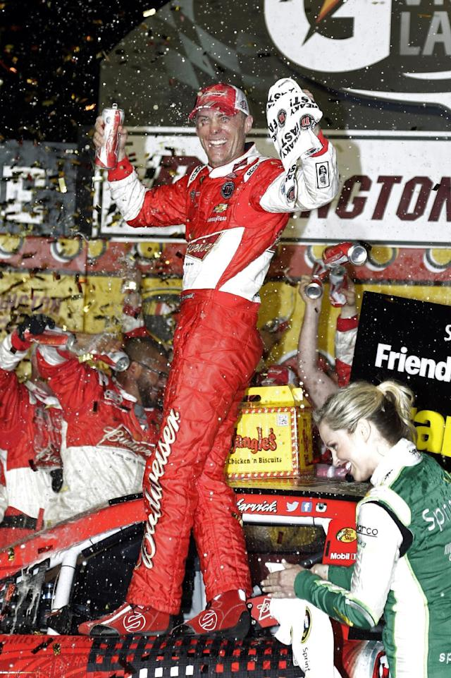 Kevin Harvick celebrates in Victory Lane after winning the NASCAR Sprint Cup auto race at Darlington Raceway in Darlington, S.C., Saturday, April 12, 2014. (AP Photo/Chuck Burton)