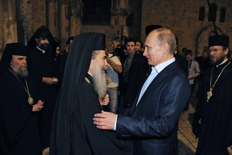 Russian President Vladimir Putin, right, is welcomed by the Patriarch of Jerusalem Theophilos III, during a visit to the Holy Sepulcher, in Jerusalem early Tuesday, June 26, 2012. (AP Photo/RIA-Novosti, Alexei Druzhinin, Presidential Press Service)