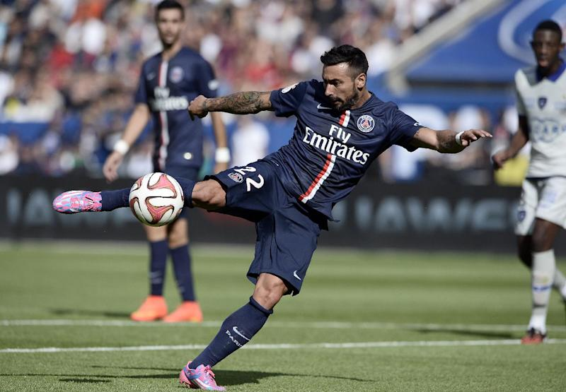 Paris Saint-Germain's Argentinian midfielder Ezequiel Lavezzi kicks the ball during their French L1 football match against Bastia on August 16, 2014 in Paris