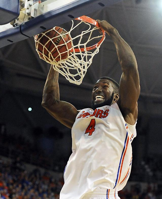 Florida center Patric Young (4) dunks during the first half of an NCAA college basketball game against Tennessee Saturday, Jan. 25, 2014 in Gainesville, Fla. (AP Photo/Phil Sandlin)