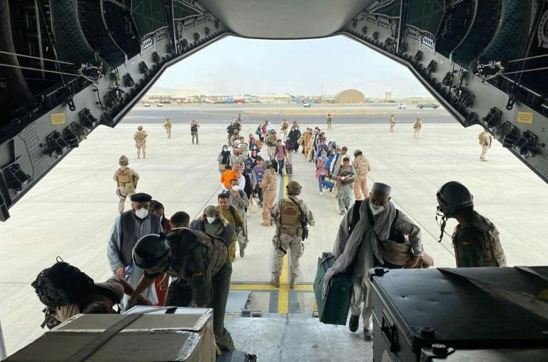 Spaniards and Afghans who worked with them board a Spanish Air Force plane to Dubai
