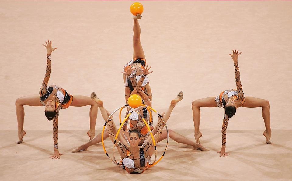 Spain dances in the rhythmic gymnastics group qualifications during the Athens 2004 Summer Olympic Games.